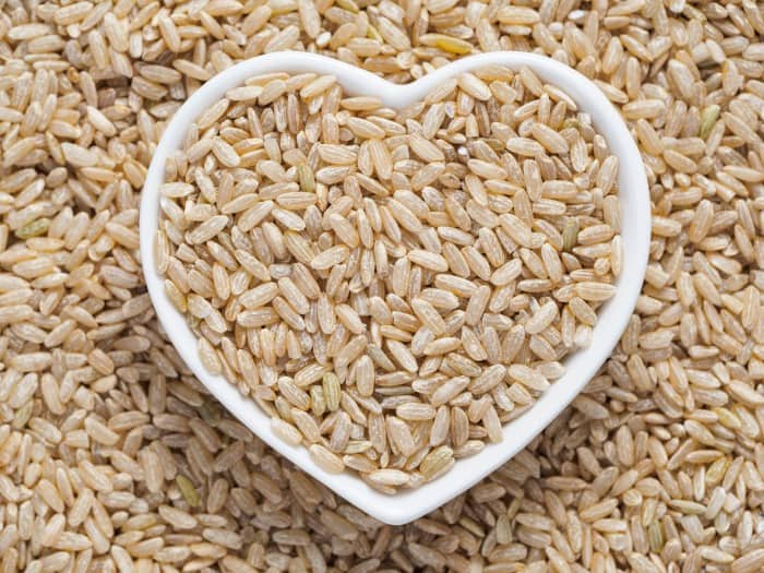 Brown rice in a heart bowl