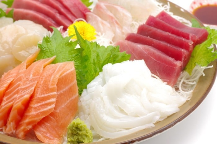 Sushi vs Sashimi - Sashimi with daikon and shiso